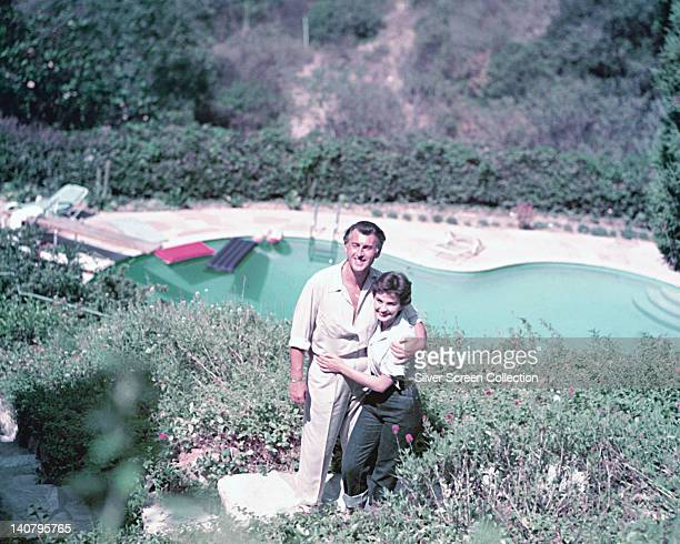 Stewart Granger British actor with his wife Jean Simmons British actress pose for a portrait with a swimming pool in the background circa 1955