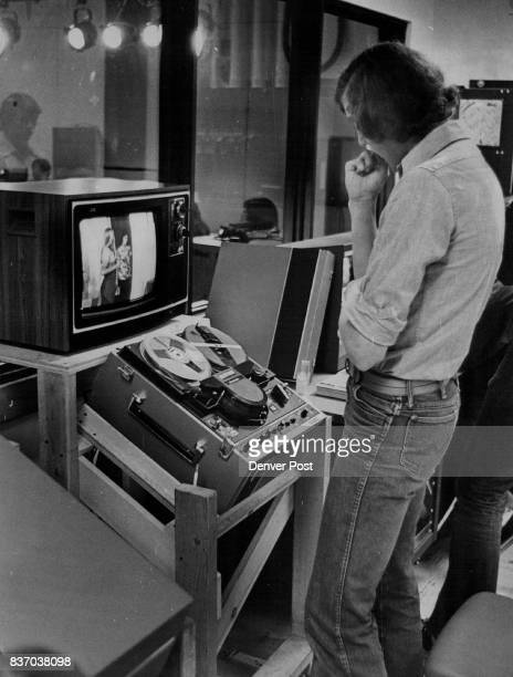 Stewart Hoover in the studio control room views television monitor screen of student quiz show Credit Denver Post