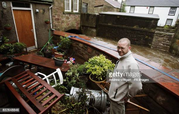 Stewart Hutchison surveys the damage to the Jolly Beggars Hotel beer garden in Milnathort near Kinross where homes were evacuated after the River...