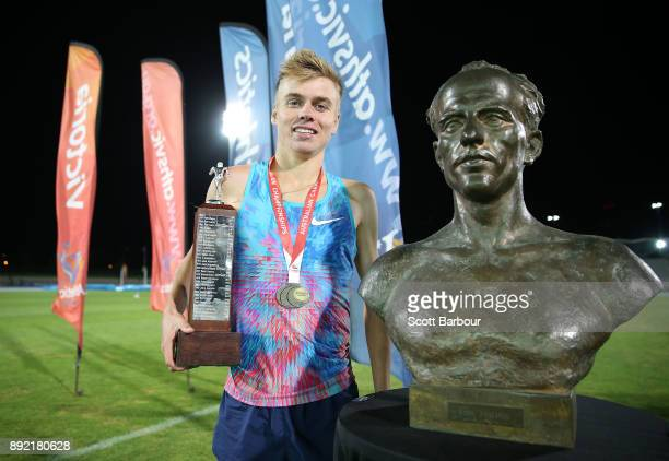 Stewart McSweyn of Tasmania poses with the trophy after winning the Mens 10000 Meter Run Open Zatopek race during Zatopek 10 at Lakeside Stadium on...