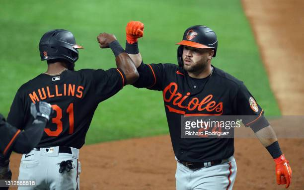 Stewart of the Baltimore Orioles celebrates his two-run home run against the Texas Rangers with Cedric Mullins in the fifth inning at Globe Life...