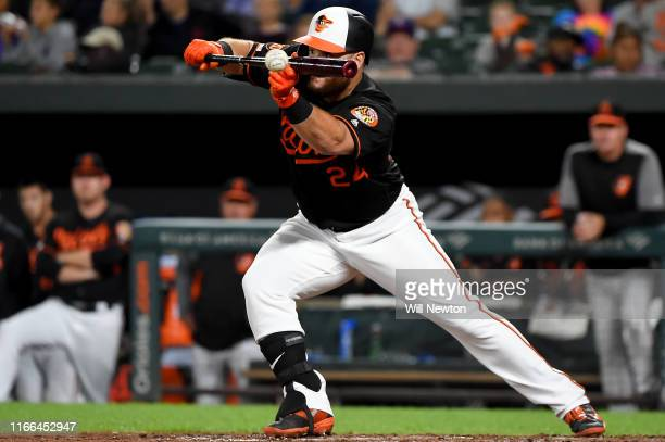 Stewart of the Baltimore Orioles lays down a bunt during the ninth inning against the Texas Rangers at Oriole Park at Camden Yards on September 6...