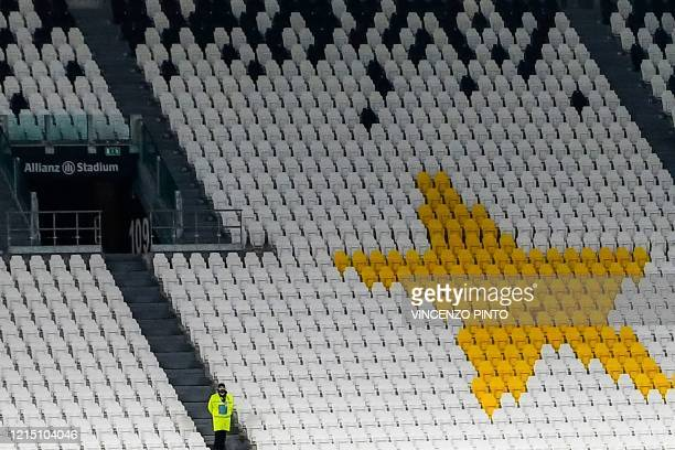 Stewart stands in an empty tribune of the Allianz Juventus stadium on March 8, 2020 in Turin during the Italian Serie A football Match Juventus vs...