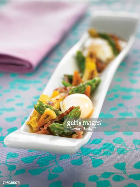 Stewed green and white asparagus with garlic diced bacon and soft-boiled eggs