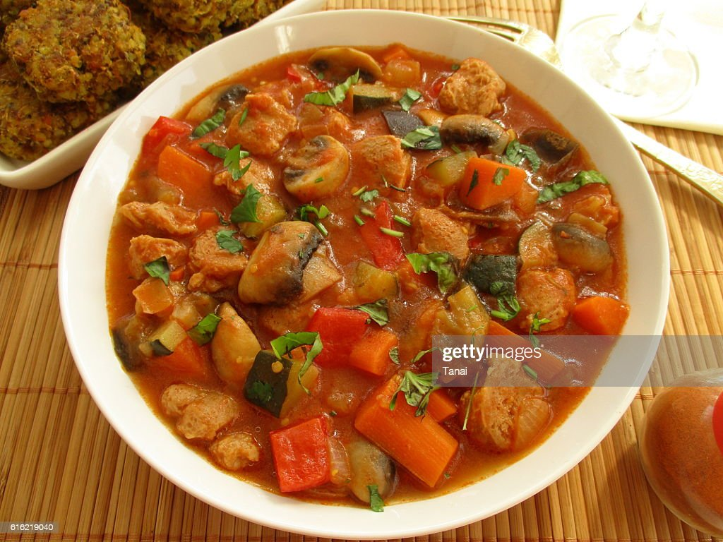 Stewed vegetables with soy and mushrooms in a white bowl : Stock Photo
