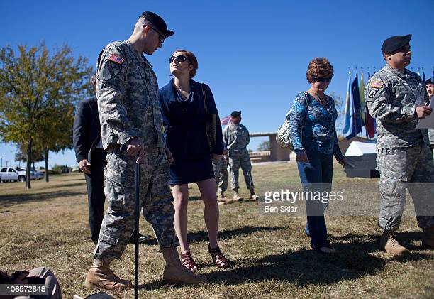 Stf Sgt Patrick Ziegler who was injured on during the Ft Hood attack walks with his fiance Jessica Hansen at a remembrance service recognizing the 13...