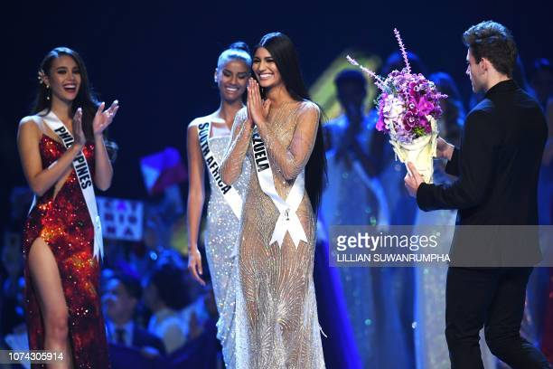 Sthefany Gutierrez of Venezuela is awarded second runner up while two finalists Catriona Gray of the Philippines and Tamaryn Green of South Africa...