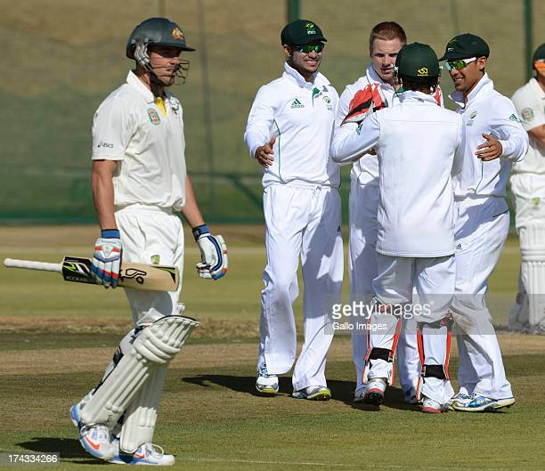 Stiaan van Zyl of South Africa A celebrates the wicket of Moises Henriques of Australia A with his team mates during day 1 of the 1st Test match...