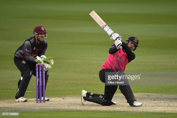 Stiaan van Zyl of Sussex hits a six as wicketkeeper Steve Davies of Somerset looks on during the Royal London OneDay Cup match between Sussex and...
