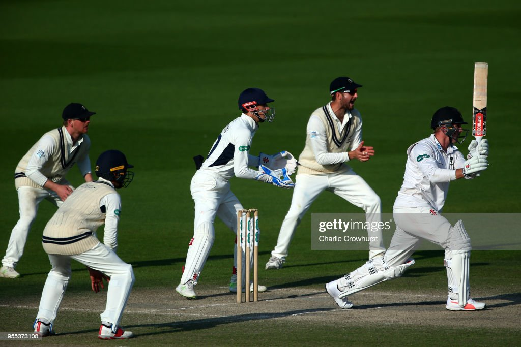 Stiaan van Zyl of Sussex hits out while John Simpson, Stevie Eskinazi, Sam Robson and Max Holden of Middlesex look on during day three of the Specsavers County Championship: Division Two match between Sussex and Middlesex at The 1st Central County Ground on May 6, 2018 in Hove, England.