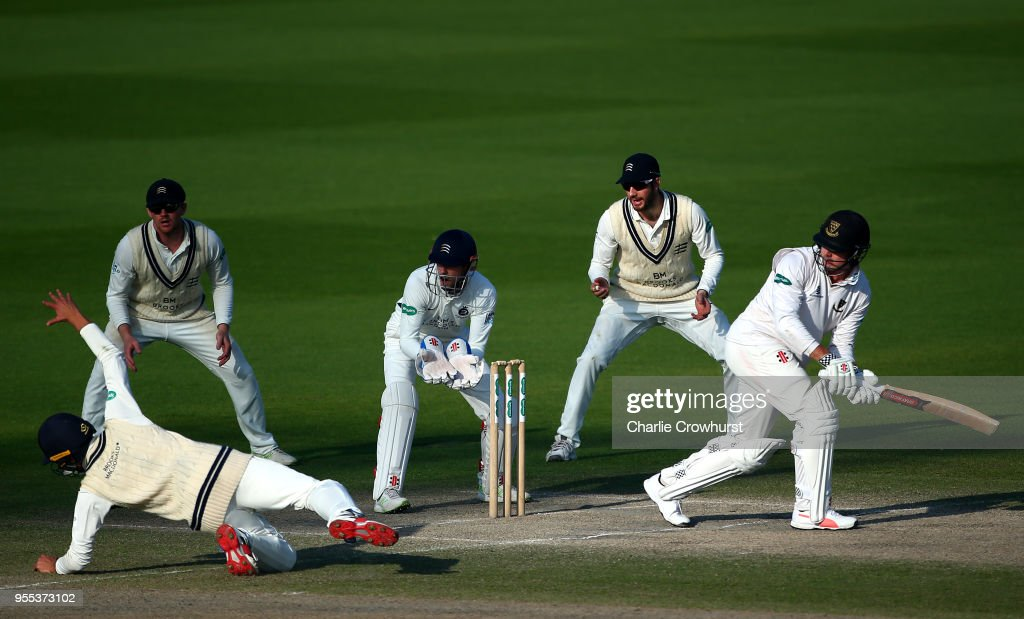 Stiaan van Zyl of Sussex hits out while Middlesex's John Simpson, Stevie Eskinazi, Sam Robson look on as Max Holden dives for the ball during day three of the Specsavers County Championship: Division Two match between Sussex and Middlesex at The 1st Central County Ground on May 6, 2018 in Hove, England.