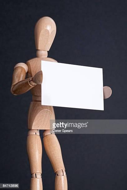 Stick Figure Holding Sign