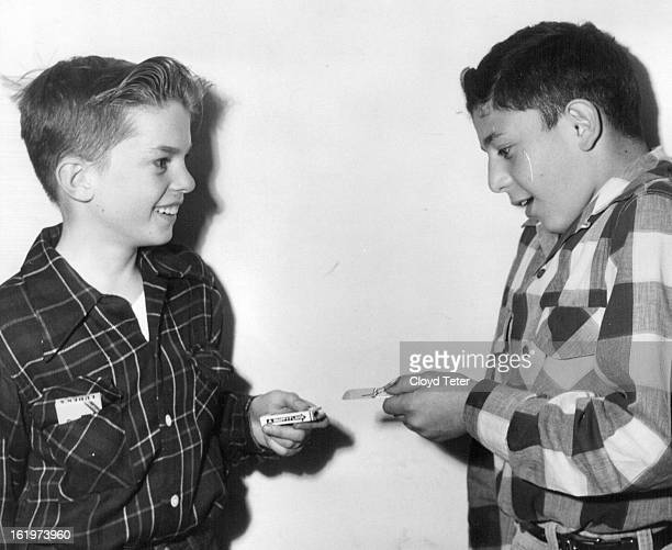 MAR 28 1953 3311953 Stick of gum with mousetrap attachment It whacks a finger when drawn from the pack At left Bob Fuller 1932 Hudson Right Freddie...