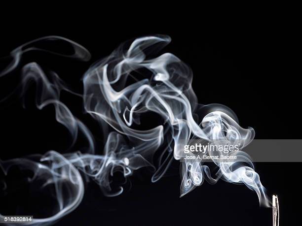 stick of incense with a stela of white smoke on black bottom - incense stock photos and pictures