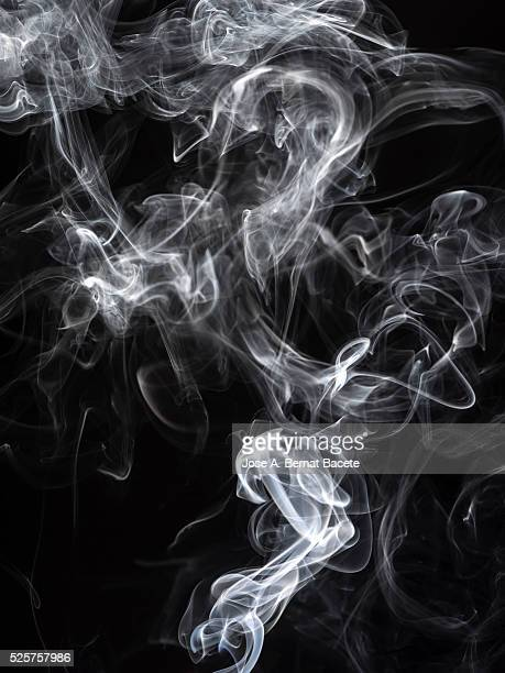 stick of incense with a stela of white smoke on black bottom - wispy stock photos and pictures