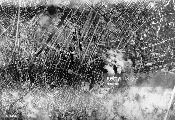 A stick of six bombs plunge down on Berlin during a heavy Allied air raid