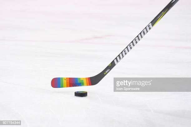 A stick with rainbow colored tape stick handles with a puck on 'Hockey is for Everyone' night before the game between the Pittsburgh Penguins and the...