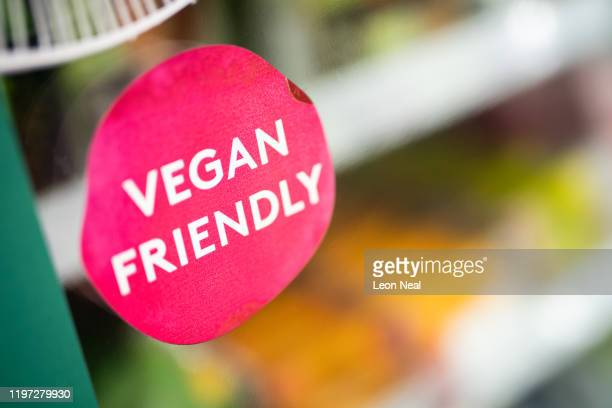 A sticker advertising veganfriendly food is seen on a fridge door in a branch of the Planet Organic healthfood store on January 03 2020 in London...