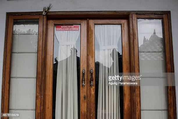 A sticker attached on a glass door of a house where Australian drug trafficker Schapelle Corby's sister and brother in law Mercedes Corby and Wayan...