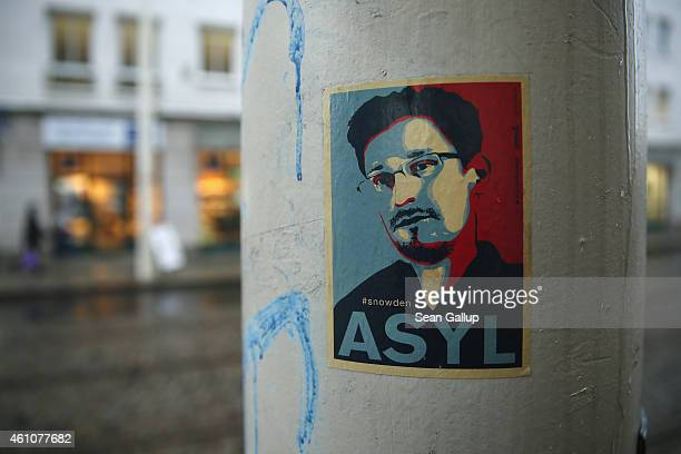 A sticker demanding asylum for whistleblower and former NSA worker Edward Snowden hangs stuck to a lamppost on January 5 2015 in Dresden Germany Many...