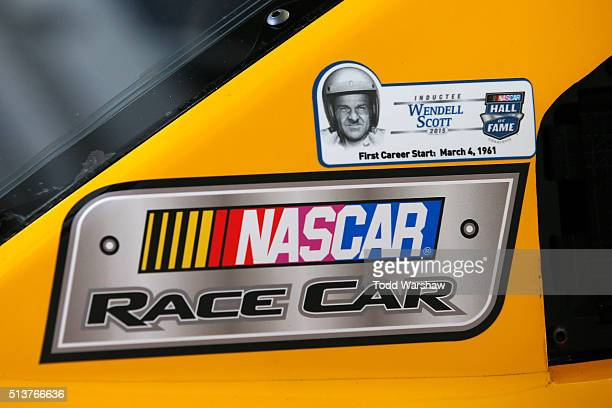 Sticker for Wendell Scott is seen on the car of Kyle Busch, driver of the M&M's 75 Toyota, during practice for the NASCAR Sprint Cup Series Kobalt...