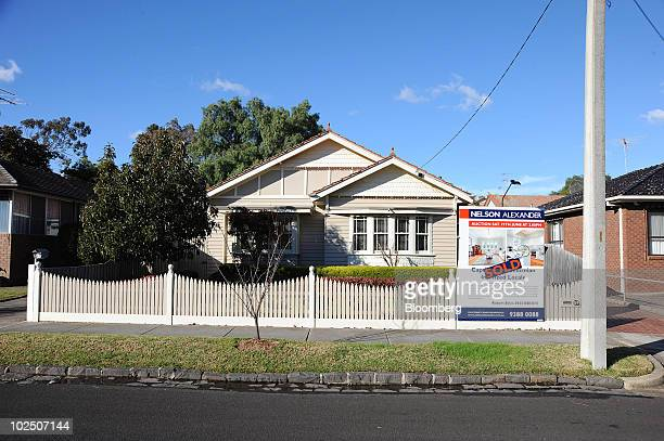 A 'SOLD' sticker has been added to a sign advertising a house for sale in Coburg a northern suburb of Melbourne Australia on Monday June 28 2010 A...