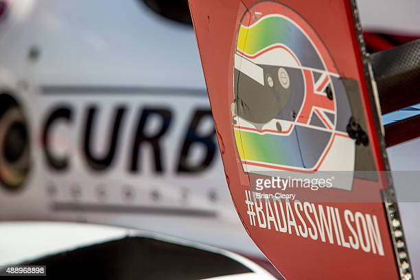 A sticker honoring the late race car driver Justin Wilson is shown on a race car during qualifying for the IMSA Tudor Series race at Circuit of The...