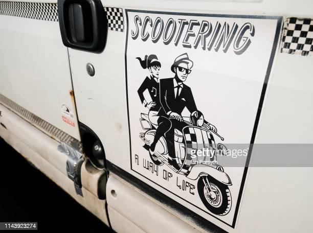 A sticker is displayed on the side of a van as scooter enthusiasts from all around the country arrive to take part in the first day of the Easter...
