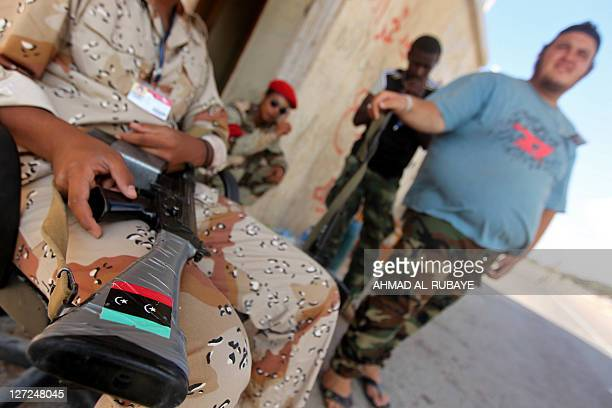 A sticker of the new Libyan flag is seen on the weapon of a Libyan National Transitional Council fighter taking position near the frontline in the...