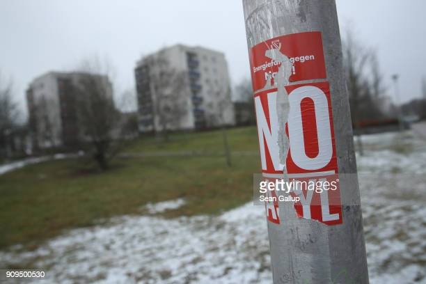 A sticker on a lamppost reads 'No Asylum' near apartment buildings in Sachsendorf district where many refugees from Syria and Afghanistan have...