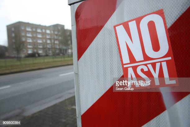 A sticker reads 'No Asylum' near an apartment building that houses both native Germans and refugees on January 23 2018 in Cottbus Germany State...
