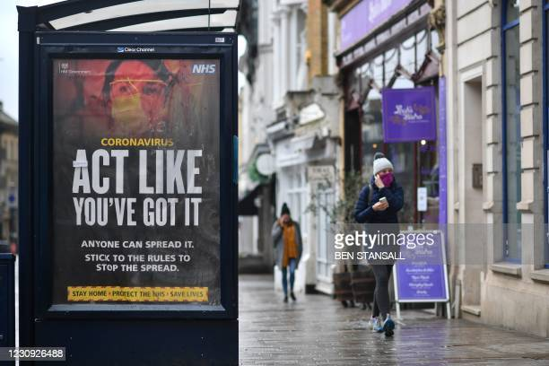 Sticker saying 'It will be ok' is attached to an NHS coronavirus guidance poster at a bus stop in Maidstone on February 2, 2021.