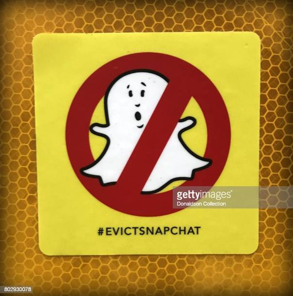 A sticker with a depiction of the Snapchat ghost and circle with a line through it reads #evictsnapchat in June 2017 in Venice California