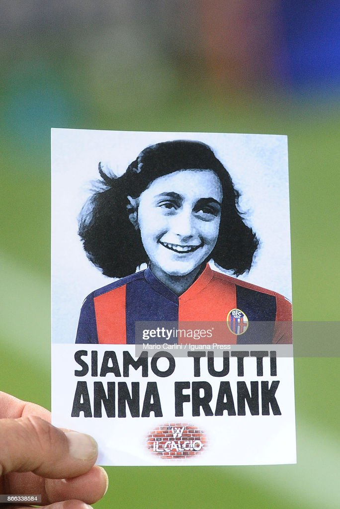 A sticker with the image of Anna Frank wearing the jersey of Bologna FC that says 'We are all Anne Frank' is given to all supporters at the gates of the stadio Renato Dall'ara prior the beginning of the Serie A match between Bologna FC and SS Lazio at Stadio Renato Dall'Ara on October 25, 2017 in Bologna, Italy.