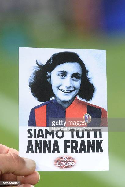 A sticker with the image of Anna Frank wearing the jersey of Bologna FC that says 'We are all Anne Frank' is given to all supporters at the gates of...