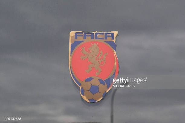 Sticker with the logo of Czech Football Association is seen on the entrance door of the FACR headquarters, as the clouds reflect on the surface, in...