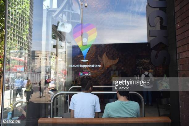 A sticker with the rainbow colours to celebrate Pride London has been put on the window of a café London on June 26 2017