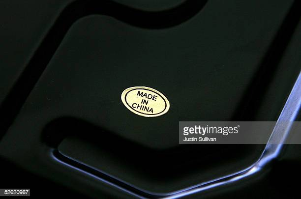 A sticker with the words Made in China is seen on the bottom of a scale April 12 2005 in San Francisco Aggravated by surging imports of oil and...