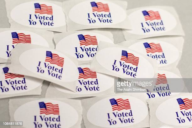 Stickers are seen at a polling station in the Midterm Election on November 6 2018 in Silver Springs Maryland