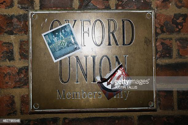 Stickers are seen stuck onto the brass plate sign at Oxford University's debating society the Oxford Union in Oxford northwest of London on February...