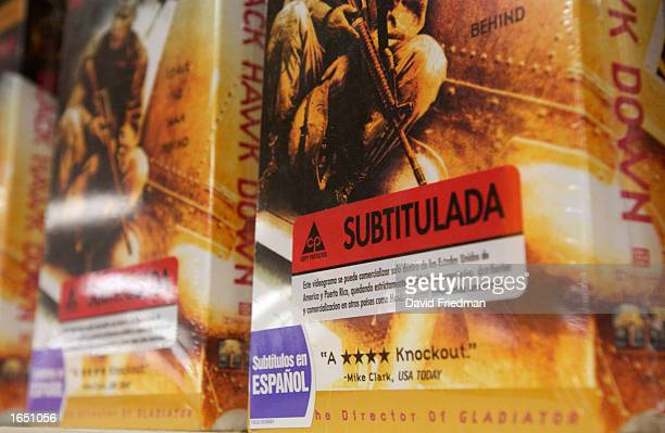 Stickers on video boxes alert customers to movies with Spanish subtitles at a Blockbuster Video store November 19 2002 in the Little Havana section...