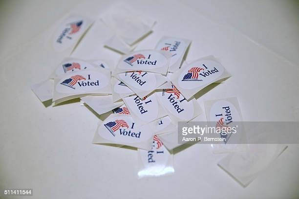Stickers printed with I Voted are seen as voters cast their ballots for the Republican primary at Our Savior Lutheran Church on February 20 2016 in...
