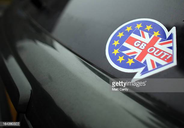 Stickers supporting the UKIP party are seen on cars parked outside at the UKIP 2013 Spring Conference being held in the Great Hall Exeter University...