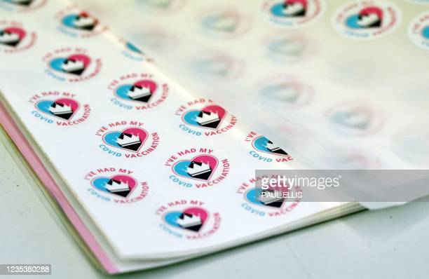 """Stickers that read """"I've had my Vaccine"""" are pictured at a Covid-19 vaccination centre in Derby, central England on September 20, 2021. - Frontline..."""