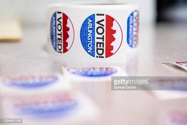 I VOTED stickers wait to be handed out to voters after they cast their ballots in the Democratic presidential primary elections at the McKinley...