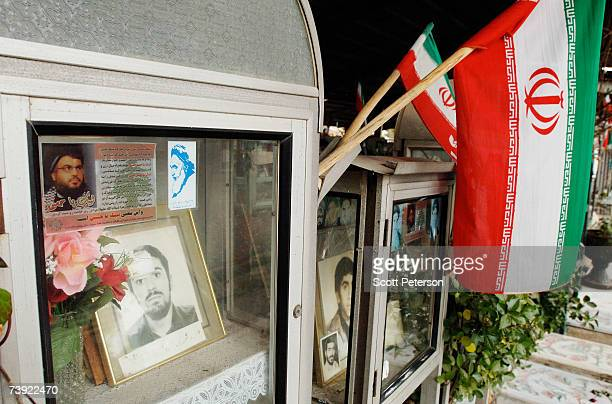 Stickers with the image of Lebanese Hizbullah leader Sheikh Sayed Hassan Nasrallah adorn Iranian graves at the Behest-e Zahra martyrs cemetery on...