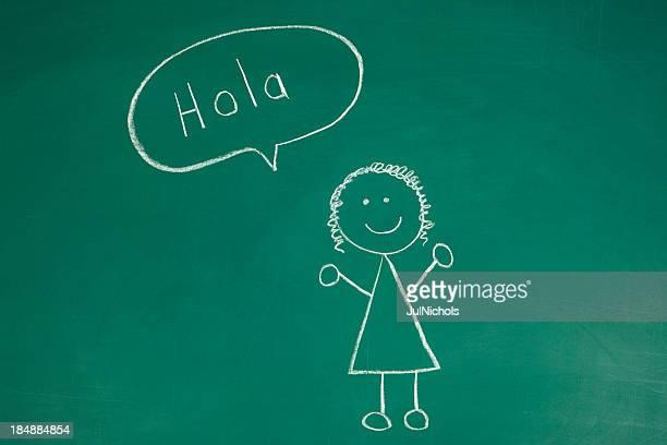 Stickfigure sagen Hallo in spanischen Malkreide-Zeichnung