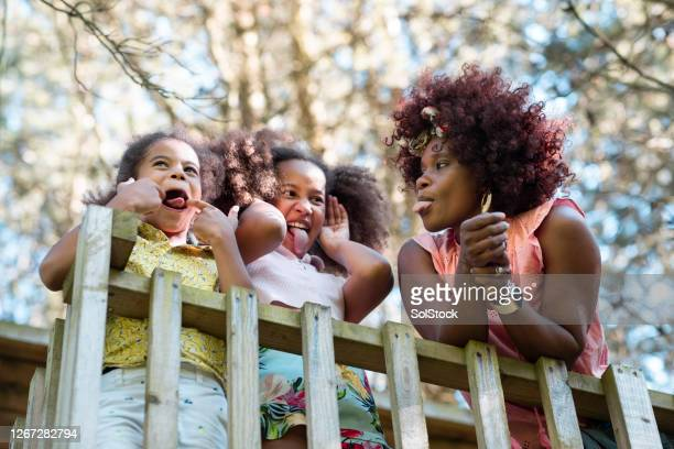sticking our tongues out - african ethnicity stock pictures, royalty-free photos & images
