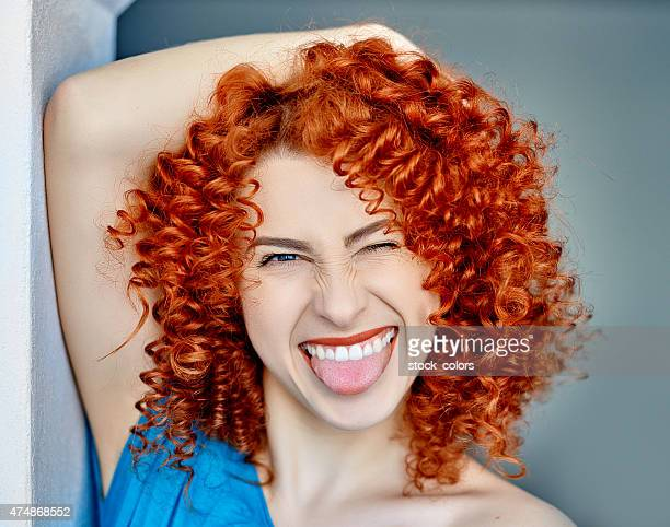 sticking out tongue and laughing - dyed red hair stock pictures, royalty-free photos & images