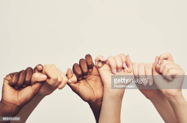 sticking together - multiracial group stock pictures, royalty-free photos & images